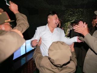 North Korea's Kim Jong Un Offers Smiles, Hugs After Missile Test