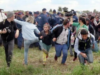 Hungarian Camerawoman Who Kicked Syrian Refugees Is Charged