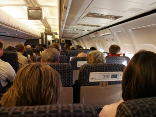 Airlines Divide Coach Cabins Along Invisible Lines
