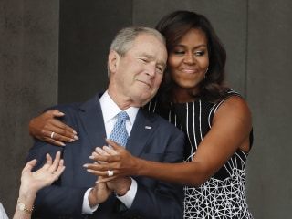 The Hug Felt Around The Country: Michelle Obama, George W. Bush Embrace at Museum Opening