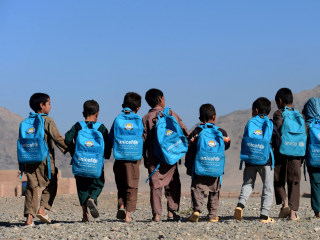 Today in Pictures: Afghan Boys Head to School and More
