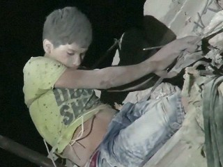 Syria White Helmets Rescue Boy Dangling From Bombed Aleppo Building