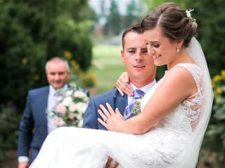 When His Bride Couldn't Walk Down the Aisle, He Carried Her