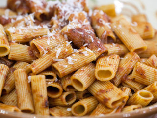 Cozy up with Anthony Bourdain's Sunday gravy with sausage and rigatoni