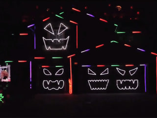 Who did it better? Two homes battle it out for best Halloween light show