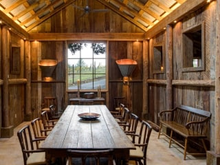 See inside! This rebuilt barn includes a yoga studio, dining space and more