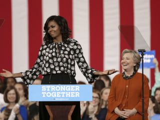 Clinton Cedes Spotlight to Fellow First Lady Michelle Obama