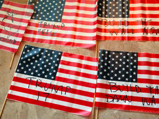 Family Finds 56 U.S. Flags, Pro-Trump Slogans on Lawn