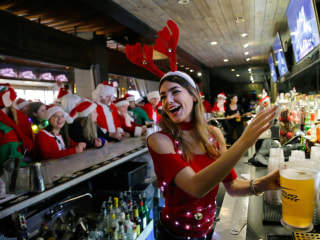 Today in Pictures:  SantaCon Hits New York and More
