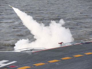 China Holds First Live-Fire Drills With Its Aircraft Carrier