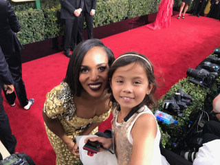 8-Year-Old Cancer Survivor Charms as Golden Globes Red Carpet Photog