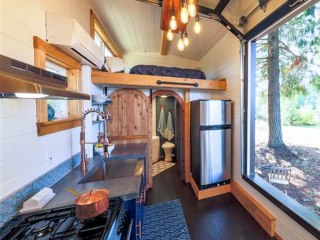 This tiny house has its own rock climbing wall — take a peek!