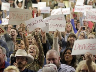 Town Hall Protests Revive Art of Bird-Dogging Politicians