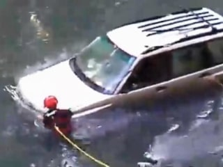 Driver Plunges into Creek, Survives 8 Hours Before Rescue