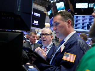 Stocks Trim Losses As Investors Weigh Trump's Tax Reform