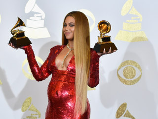 Red-Hot Mama! Beyoncé Shows off Her Baby Bump in a Dramatic Gown
