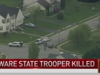 Suspect in Slaying of State Trooper Barricaded In Home
