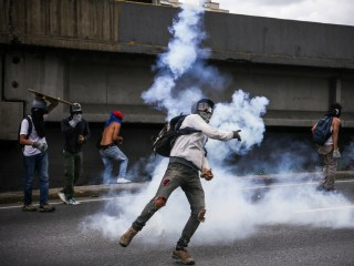 Venezuelans Battle With Shields, Gas Masks, Fecal Bombs in Latest Protests