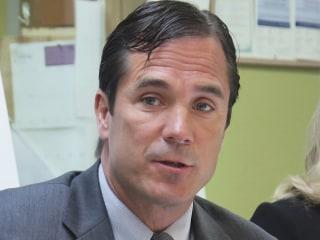 Michigan Health Chief Nick Lyon Charged in Flint Water Probe