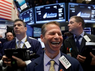 Dow Hits Another Record High as Amazon, Tech Stocks Soar