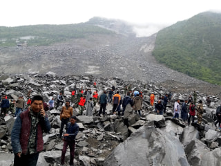 China Landslide: 141 Feared Buried in Mountain Village Landslide in Sichuan