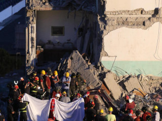 Building Collapse in Naples, Italy: 8th Body Pulled from Rubble