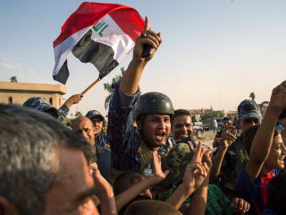 Iraqis Celebrate Bitter Victory Over ISIS in Ruins of Mosul