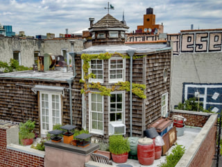 This cozy cottage is on top of a building in the middle of New York City