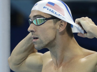 WATCH: Michael Phelps Takes On a Great White Shark