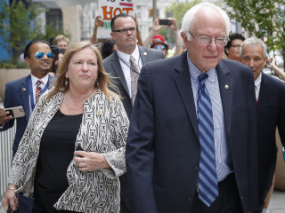 Sanders Says His Wife Did Nothing Wrong. What's This About?
