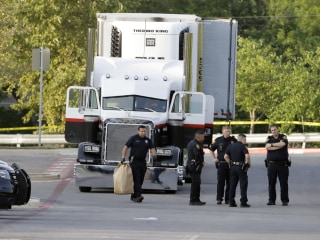Truck Driver in Custody After 9 Suspected Migrants Are Found Dead in Parking Lot