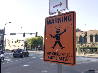 Signs Mocking Police Appear in Minneapolis After Fatal Shooting