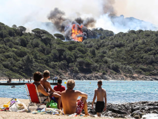 Sunbathers Watch From Beach as Wildfires Burn in French Riviera