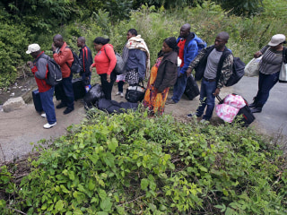 Back Road to Hope: Anxious Migrants Stream Into Canada at Remote Outpost