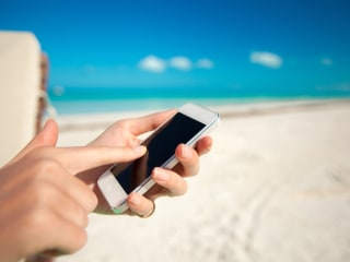3 Hacks for Keeping Sand Off Your Stuff at the Beach