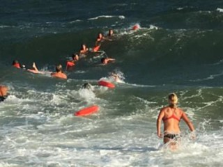 Rescuers Form Human Chain to Save Swimmer off Beach