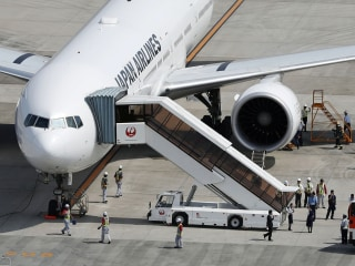 Japan Airlines Flight Makes Emergency Landing After Engine in Flames