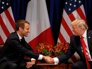 Trump Talks Parisian Parade Pomp, Offers Support for U.N. Reform