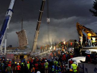 Desperate Rescuers Dig Through Rubble After Powerful Mexico Quake
