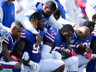 NFL Players Lock Arms and Kneel During National Anthem to Protest Trump Tweets