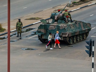 Zimbabwe army has Robert Mugabe in custody and seizes state TV