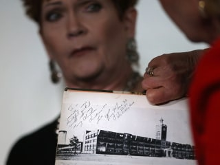 Moore accuser says she added notes to his yearbook message