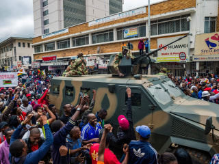 Euphoric Zimbabweans descend on capital to march against Mugabe