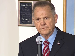Roy Moore vows to keep fighting in first public appearance since scandal broke