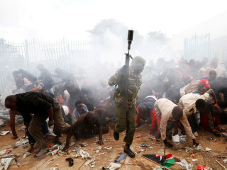 Supporters storm gates during Kenya's presidential inauguration
