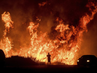 1st death in California wildfires reported, firefighters make progress
