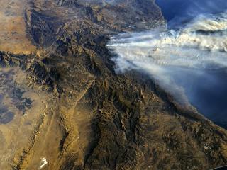 California wildfires' vast scale seen in astronaut's photos