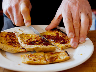 People are really freaking out over the correct way to cut toast