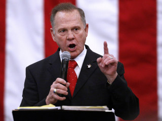 Moore attacks accusers on election eve