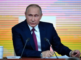 Putin praises Trump on economy, says Russia collusion claims are 'invented'